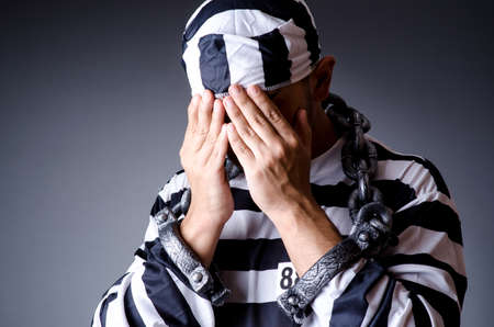 Convict criminal in striped uniform Stock Photo - 19013225