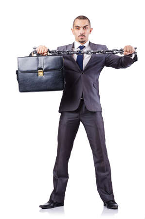 Businessman with shackles on white photo