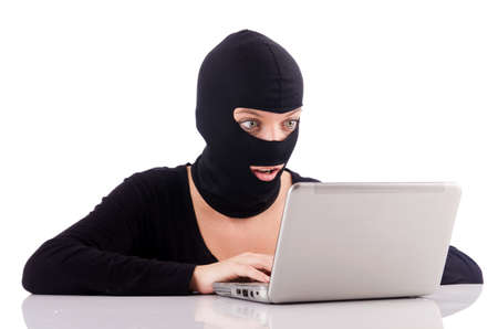 Hacker with computer wearing balaclava Stock Photo - 19032464