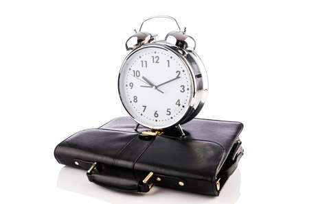 Alarm clock and briefcase isolated on white Stock Photo - 19037420
