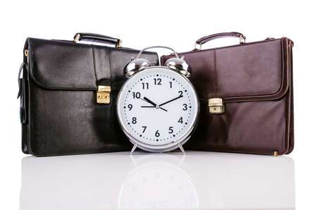 Alarm clock and briefcase isolated on white Stock Photo - 19039578