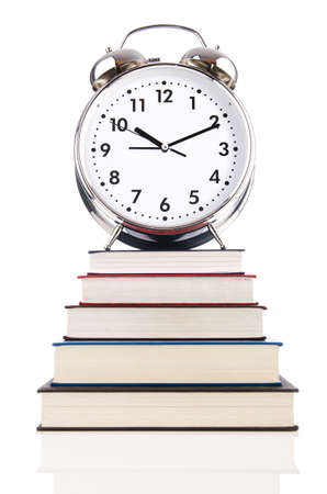 Alarm clock and books isolated on white Stock Photo - 19037256