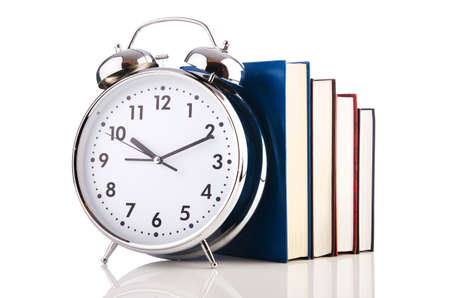 textboks: Alarm clock and books isolated on white