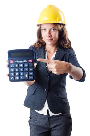 Female builder with calculator on white Stock Photo - 19292454