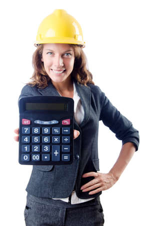 Female builder with calculator on white Stock Photo - 19292418
