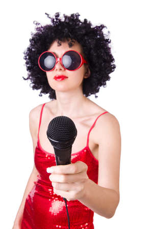 Pop star with mic in red dress on white photo