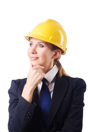 Young businesswoman with hard hat on white Stock Photo - 19292391