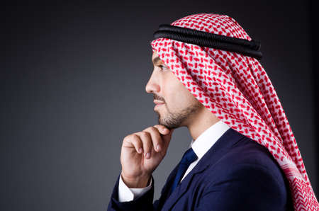 thoub: Arab businessman in dark studio Stock Photo