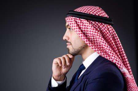 qameez: Arab businessman in dark studio Stock Photo