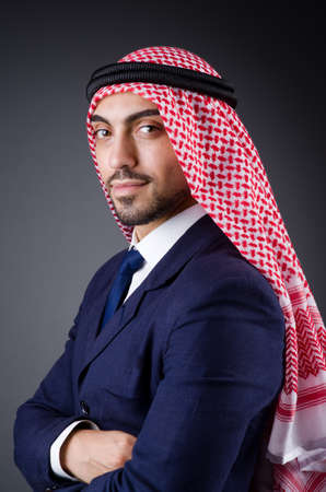 Arab businessman in dark studio photo