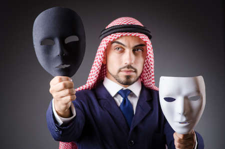 Arab with masks in dark studio Stock Photo - 19292534