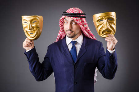 Arab with masks in dark studio Stock Photo - 19142358