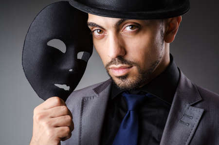 Man with mask in the dark Stock Photo - 19142361