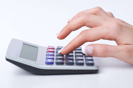 Hands working on the calculator Stock Photo - 19037504