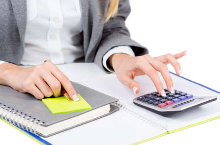 Hands working on the calculator Stock Photo - 19039092
