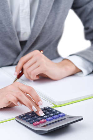 Hands working on the calculator Stock Photo - 19039157
