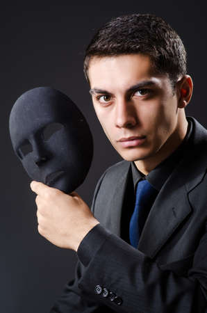 insincere: Man with mask in the dark