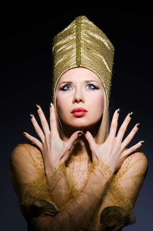 Young model in personification of egyptian beauty photo