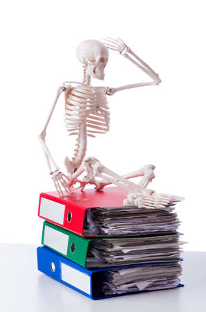 overworking: Skeleton with pile of files on white
