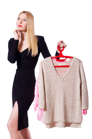 Woman trying to choose dress on white Stock Photo - 19198655