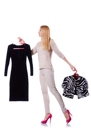 Woman trying to choose dress on white Stock Photo - 19131365