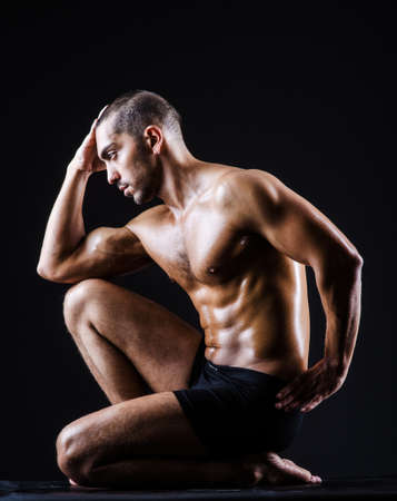 Muscular man in dark studio Stock Photo - 19137019