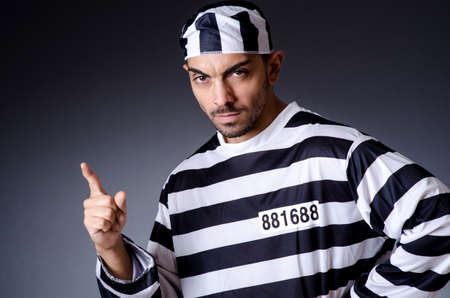 Convict criminal in striped uniform Stock Photo - 19137057