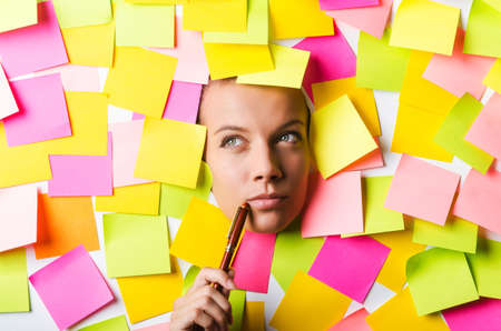 Businesswoman with lots of reminder notes Stock Photo
