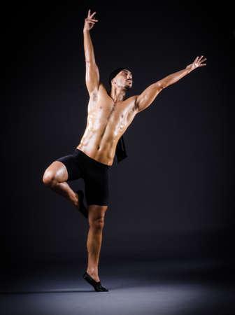 Dancer dancing in the dark studio Stock Photo - 19142720
