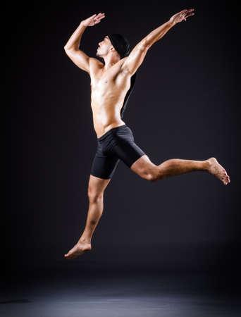 Dancer dancing in the dark studio Stock Photo - 19142678