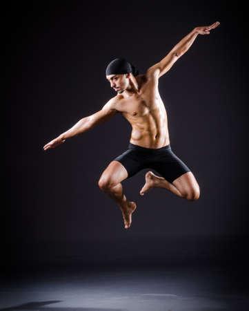 Dancer dancing in the dark studio Stock Photo - 19142722