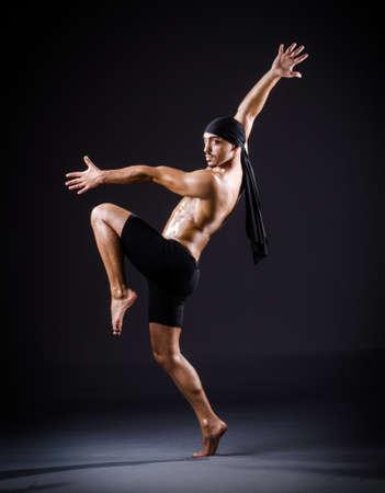 Dancer dancing in the dark studio Stock Photo - 19142681