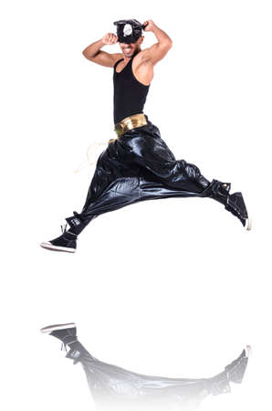 Rap dancer in wide pants on white Stock Photo