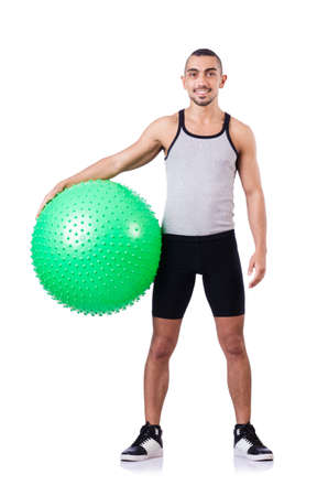 Man with swiss ball doing exercises on white Stock Photo - 19142511