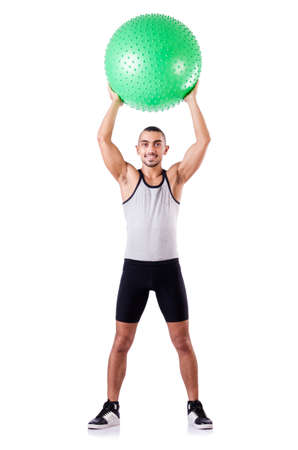 Man with swiss ball doing exercises on white Stock Photo - 19142413