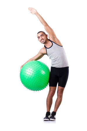 Man with swiss ball doing exercises on white Stock Photo - 19142448