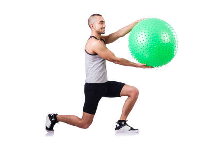 Man with swiss ball doing exercises on white Stock Photo - 19142411