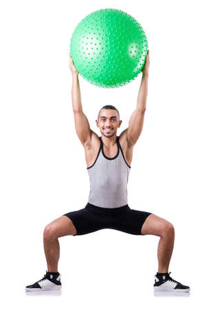 Man with swiss ball doing exercises on white Stock Photo - 19142461