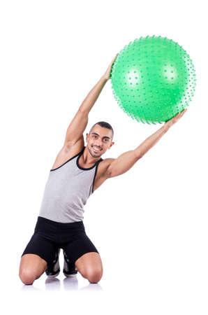Man with swiss ball doing exercises on white Stock Photo - 19142494
