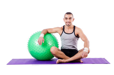 Man with swiss ball doing exercises on white photo