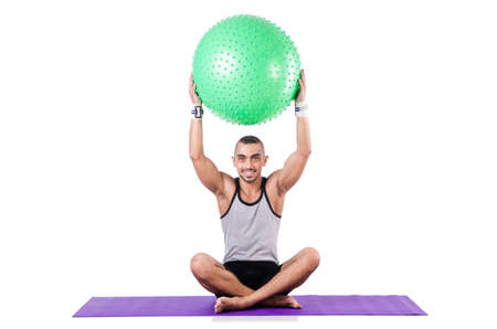 Man with swiss ball doing exercises on white Stock Photo - 19142453