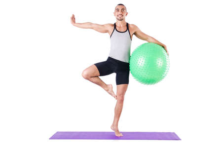 Man with swiss ball doing exercises on white Stock Photo - 19142395