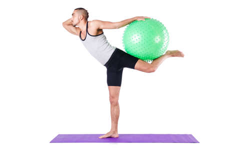Man with swiss ball doing exercises on white Stock Photo - 19142408