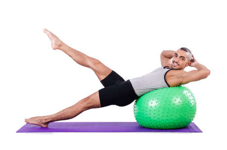 Man with swiss ball doing exercises on white Stock Photo - 19142493