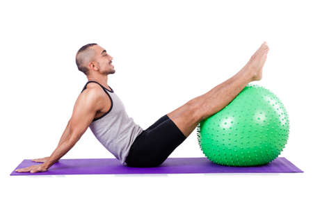 Man with swiss ball doing exercises on white Stock Photo - 19142527