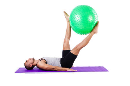 Man with swiss ball doing exercises on white Stock Photo - 19142433