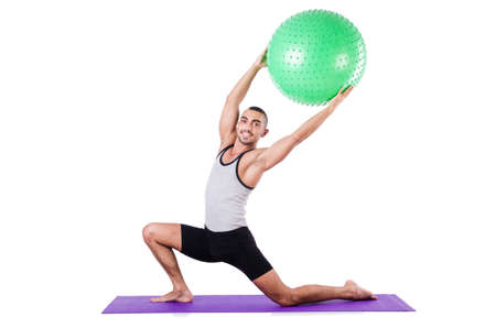 Man with swiss ball doing exercises on white Stock Photo - 19142397