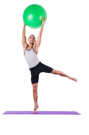 Man with swiss ball doing exercises on white Stock Photo - 19142368