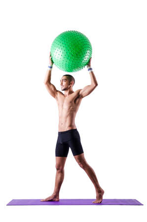 Man with swiss ball doing exercises on white Stock Photo - 19142401