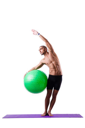 Man with swiss ball doing exercises on white Stock Photo - 19142394